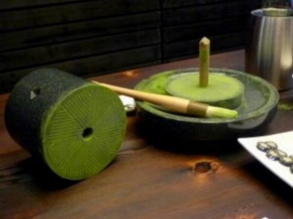 Traditional granite wheel used for hand-grinding matcha leaves into a fine powder